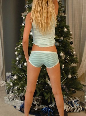 Nineteen yr old platinum-blonde girl shows off her naked donk in front of the Xmas tree
