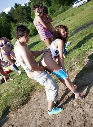 Puny teenage bi-otches enjoy a sultry groupsex with nasty guys outdoor