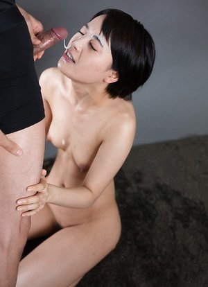 Nice tiny Asian girl gets on her knees nude to gargle man sausage for a throatful