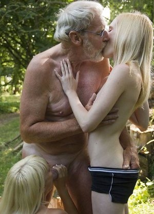 Young ash-blonde women give an old guy a double gargle off during a three way