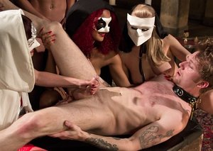 Group of molten masked dommes abase collared masculine slave with jacking & denial