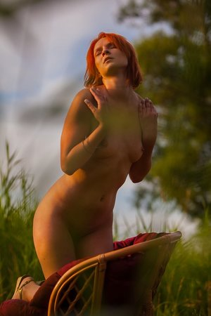 Erotic ginger Andrea P massages her amazing naked figure at sunset