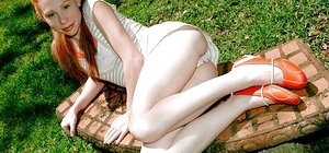 Small teenage bare model Trinity Cole in erotic outdoor shoot