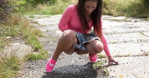Nicolette Noir droplets her jeans cut-offs and squats to eased piss on the path