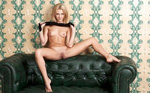 Euro stunner Thea C shows her soles and cunny as she takes her pantyhose off