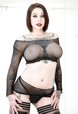Inked model Harlow Harrison taunts in luxurious fishnet garment and ebony shoes