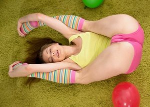 White teen Merry Pie plays with her vulva in striped knee socks