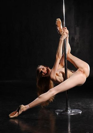 Acrobatic Annett A stretches long gams naked to pillar dance displaying shaved muff