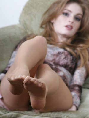 Pallid redhead pulls down her tights and inserts a bullet vibro in pussy