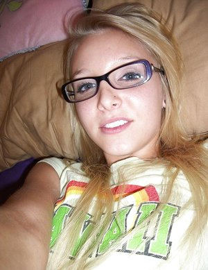 Nerdy teen woman takes selfies of her revealed hooters and micro cut-offs