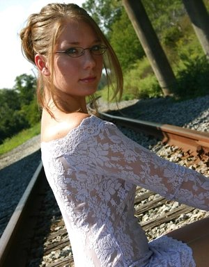Inexperienced solo damsel poss non bare on teach tracks in tight dress and glasses