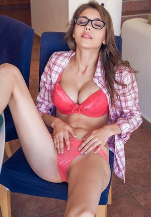 Glasses clad hotty Mila Azul looks steaming with hard knockers bare in the window