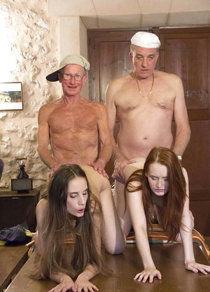 2 young chicks have lovemaking with a duo of indeed old boys simultaneously