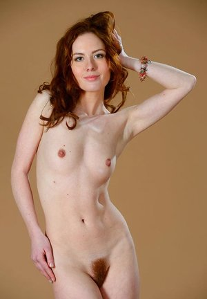 Lean redhead Adel P displays her clean-shaved muff and plasticity at once