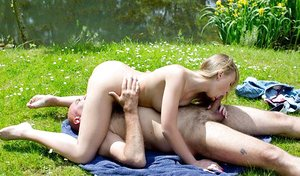 Blondie teen and her sugar daddy get together for hook-up down by the pond