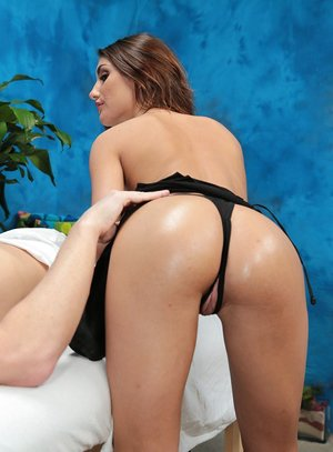 Steamy black-haired masseuse with puffy titties in high-heeled shoes railing client cowgirl style
