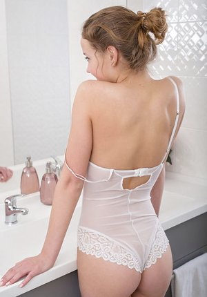Lovely youthful Faina Bona takes off white sheer undergarments to display closeup cooter