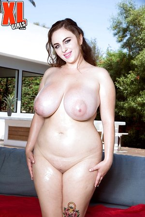 Solo dame Milly Marks lubricates up her melons after removing her white dress