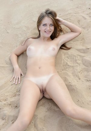 Naked beach bunny Marika shows puffy breasts & spectacular trimmed honeypot in the sand