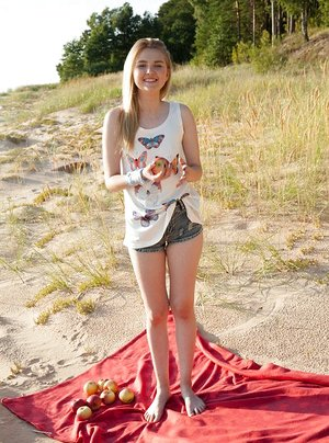 Smiley blondie Nimfa opening up on a blanket outdoors to demonstrate off her hairless taco