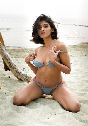 Passionate remarkable beach bunny Angel Constance takes off bikini revealing steaming physique