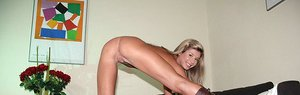 Youthful ash-blonde hottie in shoes stretching gams to showcase trimmed slit for cash