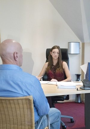 Youthful office worker Rebecca Ruby saves her job by pummeling her older boss