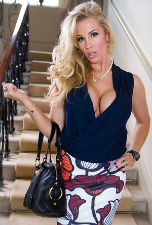 Milf Rebecca More comes home after shopping and disrobes right on the stairs