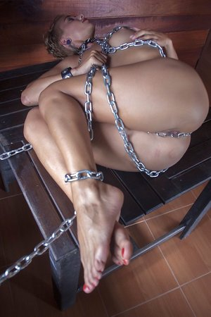White girl with brief hair and inborn baps models bare in chains