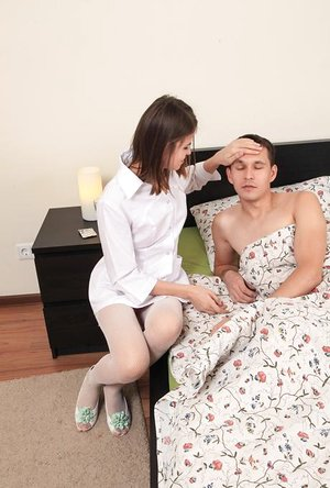 Youthfull Euro nurse in white tights has unique way to take man's temperature
