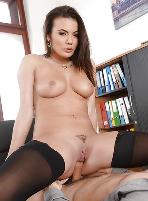 Curvaceous dark-haired in tights and high high-heeled shoes Vanessa Decker is ravaged on table