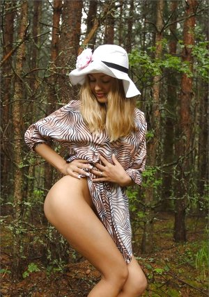 Adorable light-haired Tasty Lilya hoists dress for remarkable upskirt in the forest & romps bare