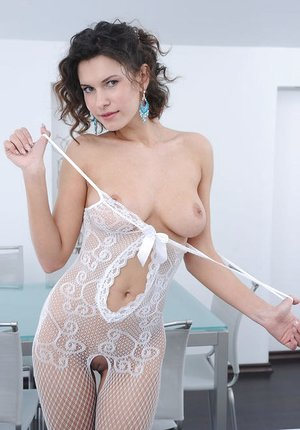 Erotic stunner Suzanna A in stockings unwrapping to stretched gams wide open