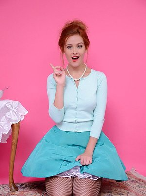 Redhead chick Elle Richie liquidates her outfit with help from vacuum cleaner
