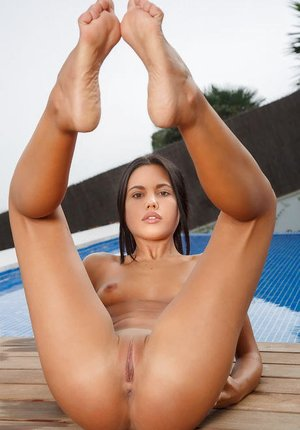 Wonderful raven-haired looker Apolonia likes stretching her sexy gams