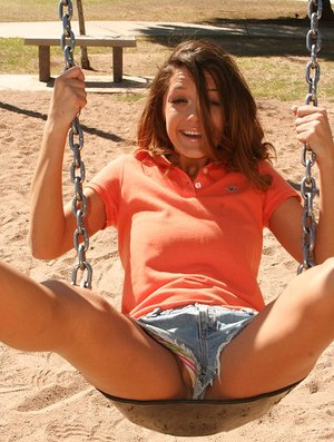 Teenage fledgling Brittany Maree flashes her undergarments on playground sway set