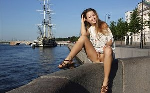 Leggy hottie gives bare upskirt on the pier then takes off entirely bare