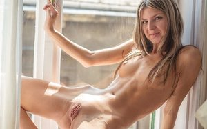 Slender young woman Gina G doffs sheer lingerie to hit molten poses in the naked