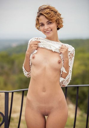 Teenage sol chick Ariel A poses her killer assets in the bare on balcony