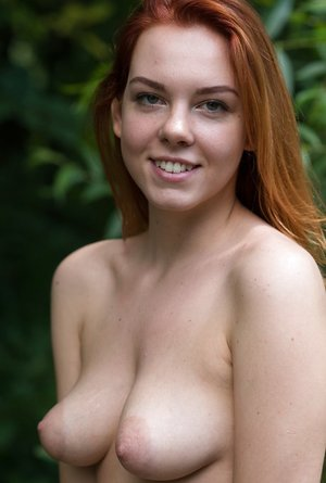 Innate redhead Candy Crimson an her puffy baps go for a naked walk in the forest
