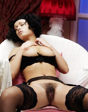 Huge-chested Pammie Lee in black stockings opening up gams to paw her furry slit