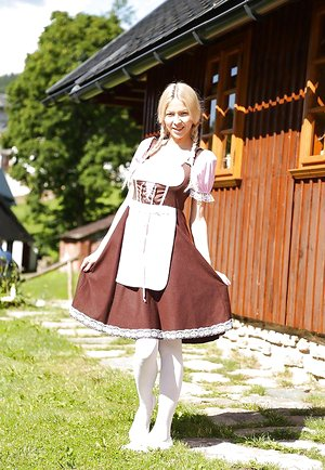 Swiss farm dame Karol Lilien toying cunny on lawn in pigtails