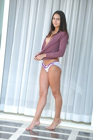 Black-haired female Cira Nerri sports a cameltoe before modelling in the bare