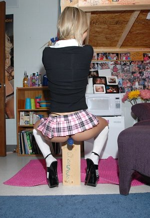 Spectacular ash-blonde teenage Kasia in micro skirt and socks bending over to flash her bum