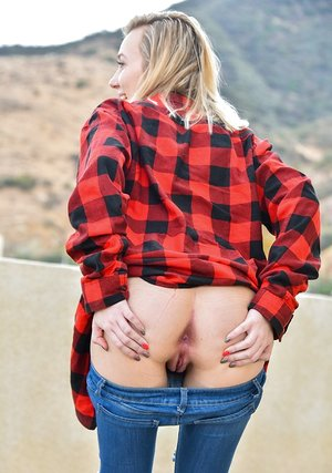 Insatiable teenage Jasmine shows close up thong jammed cootchie and stretches arse outdoors