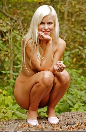Lean unspoiled tenderness Dido A with platinum-blonde hair and lil' cunny poses outdoors