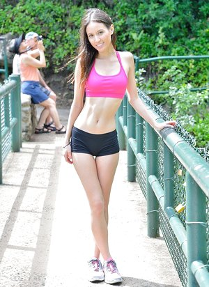 Lean teenage lesbians in workout clothes disrobe outdoors in forest