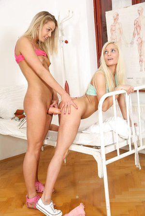Youthful platinum-blonde women get handed vibros and are off to investigate sapphic lovemaking