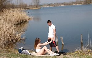 Mischievous teenage female deep-throats the jizz from her guy's beef whistle after hookup by the water