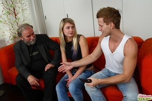 Young blond chick has lovemaking with her boyfriend's grandfather on the sofa